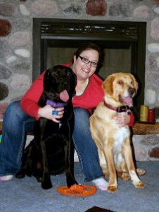 With Labrador mix, Bella, Charlie's bonded companion.